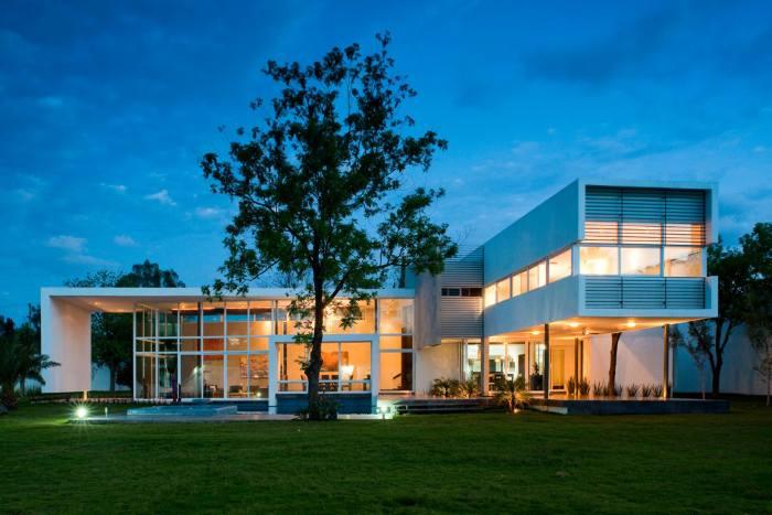 Casa en El Uro, por 7XA Arquitectura