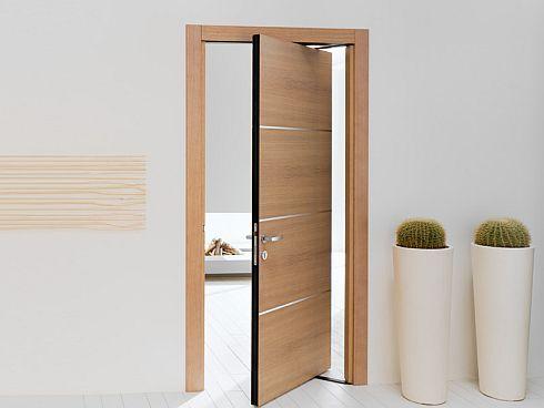 Ergon moderna puerta que se abre en dos sentidos for Puerta que se abre sola