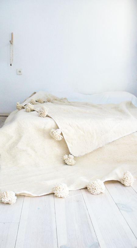 mantas con pompones