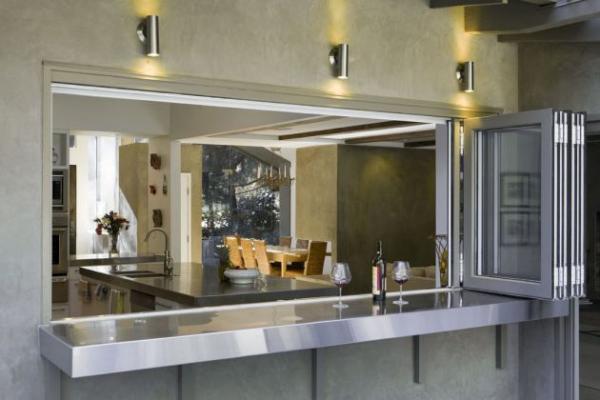 Remodelaci n de una casa de l neas cl sicas for Desayunadores de concreto